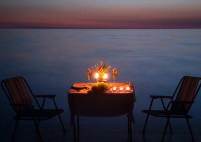 discover-punta-cana-beach-estate-couple-beach-dinner-table
