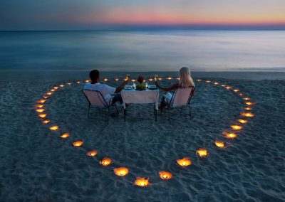 discover-punta-cana-beach-estate-couple-beach-heart-sand